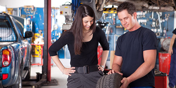 mechanic showing tire
