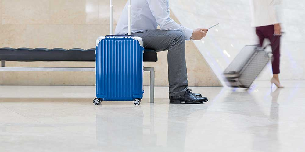 man with blue luggage