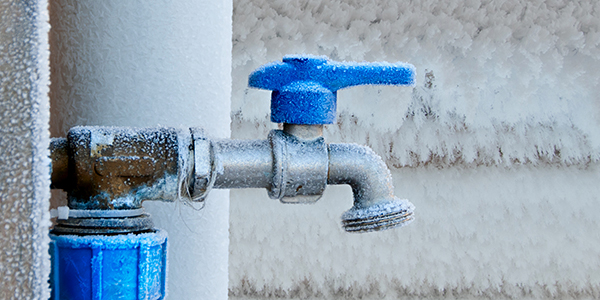 blue faucet and pipe